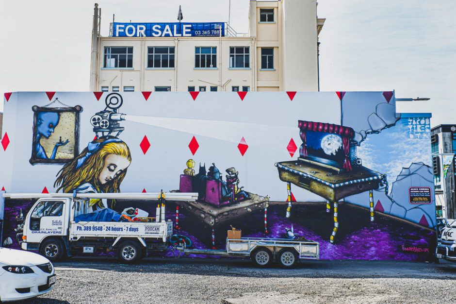 Cinema-themed mural of Alice in Wonderland by Jacob Yikes on Alice Cinema in Christchurch