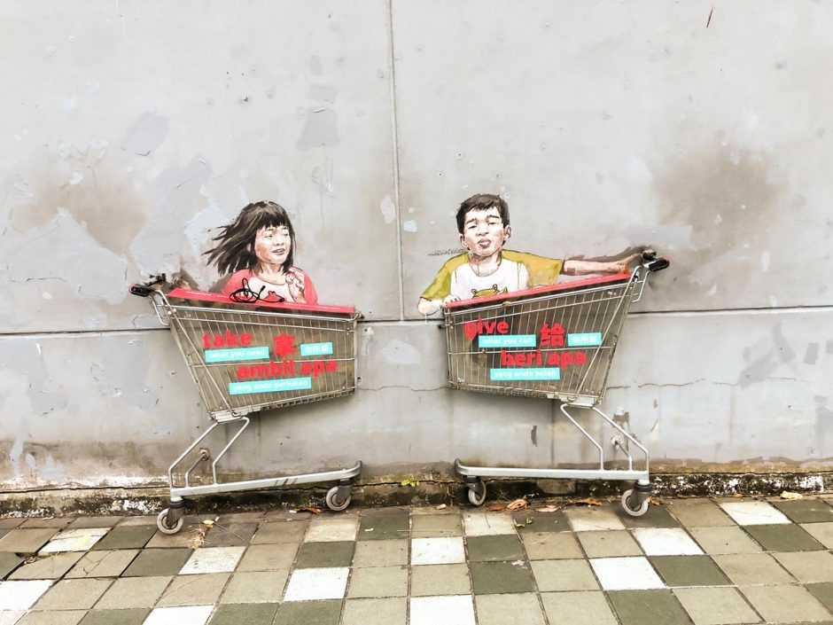Victoria Street Singapore street art of kids in a trolley by Ernest Zacharevic