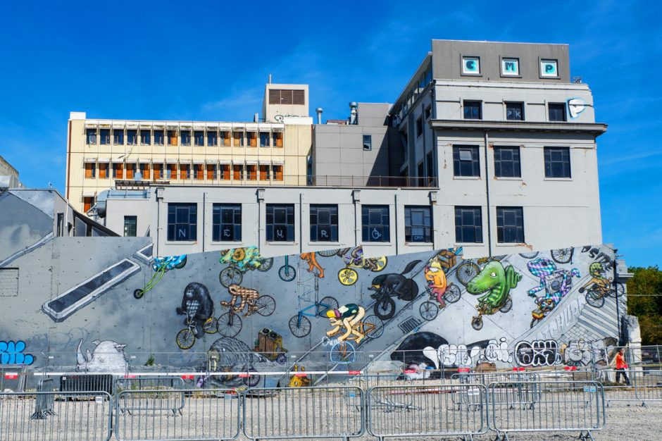 Cartoon-style mural of humans and animals on bikes on Oxford Terrace in Christchurch