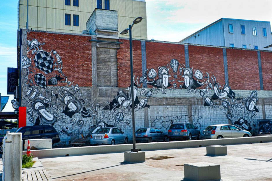 Black and white cartoon-style mural on Hereford Street in Christchurch