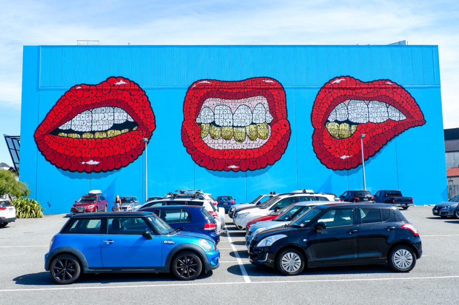 Street art of three red-lipped mouths by Tilt in the Christchurch Casino parking lot