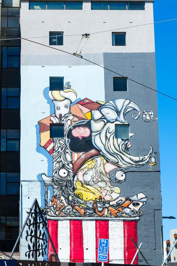 Cubist-style street art painting by Jacob Yikes