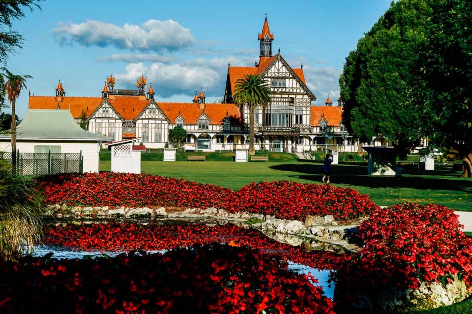 Rotorua Museum in the Government Gardens with a sea of red flowers in the foreground