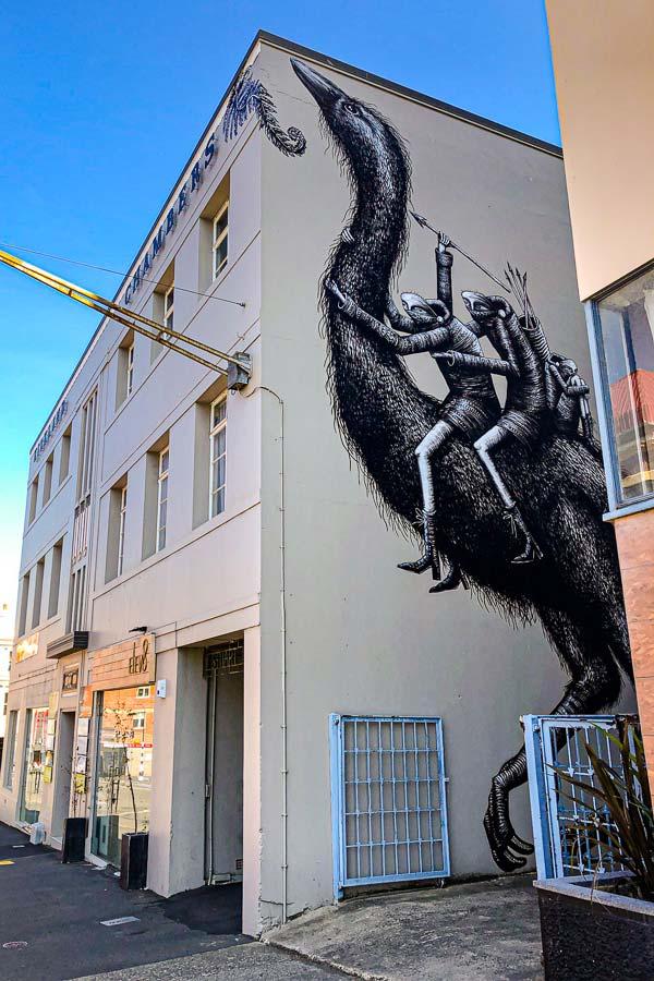 mural of fantasy creatures riding a Moa