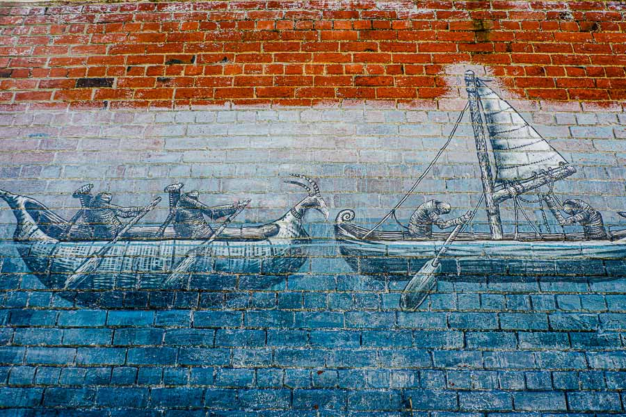 close-up of the mural by Phlegm showing his fantasy creatures rowing the wooden vessels