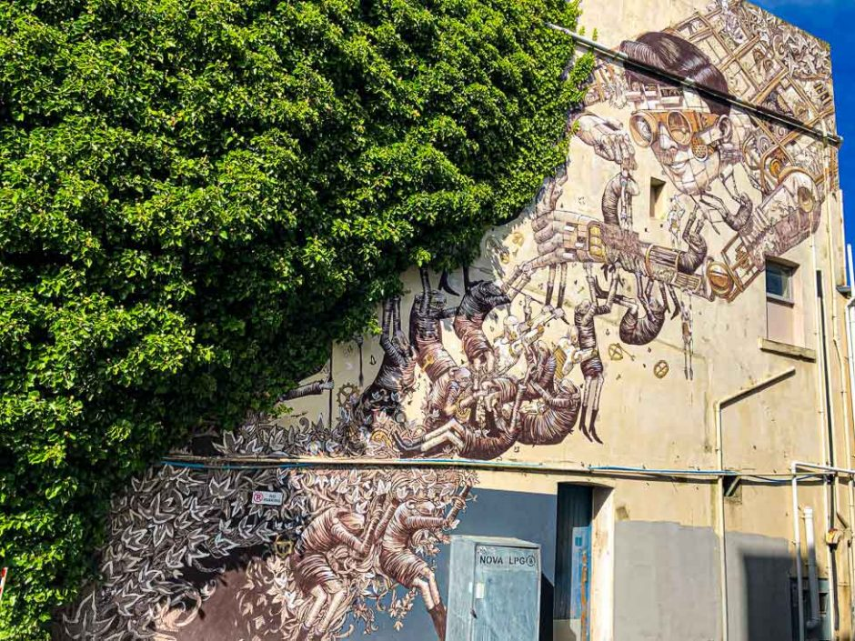 mural combining a human-like robot by Pixel Pancho with the fantasy creatures by Phlegm
