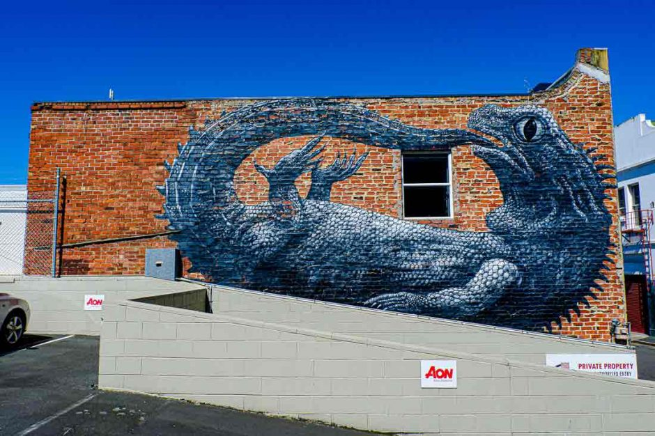 large black and white mural of the tuatara reptile
