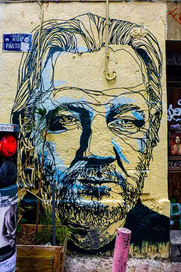 large stencil art which is a portrait of Julian Assange