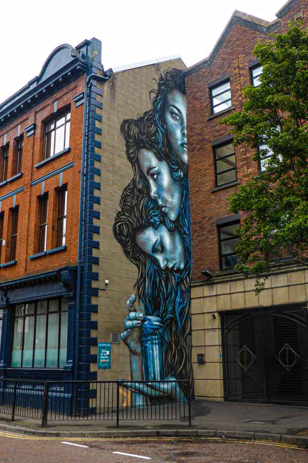 street art in Belfast by Starfighter three portraits of a woman