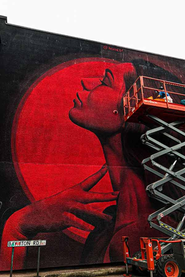 street art in Bristol by Insane51 who's on a cherrypicker whilst painting