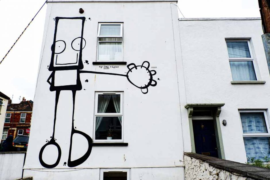 street art in Bristol by My Dog Sighs of a cute cartoon figure on a house
