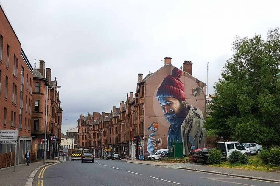 street art in Glasgow by Smug portrait of a man with a bird on his finger