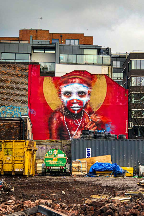 street art in Manchester by Dale Grimshaw portrait of an indigenous person of New Guinea
