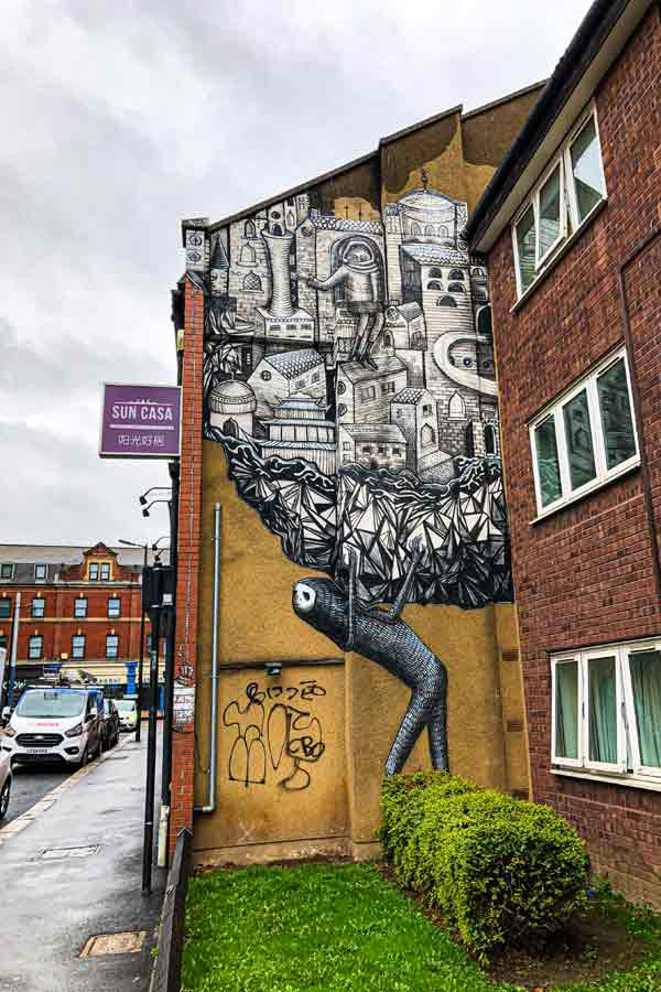 street art in Sheffield by Phlegm of his signature mythical creatures in black and white