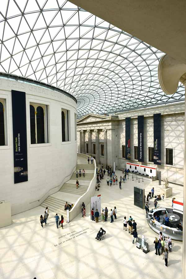 Entrance of the British Museum in London with its impressive glass ceiling and white interior