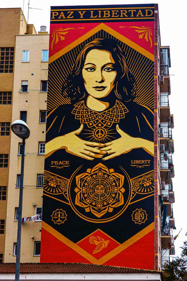 Part of an apartment block with a large mural by Shepard Fairey
