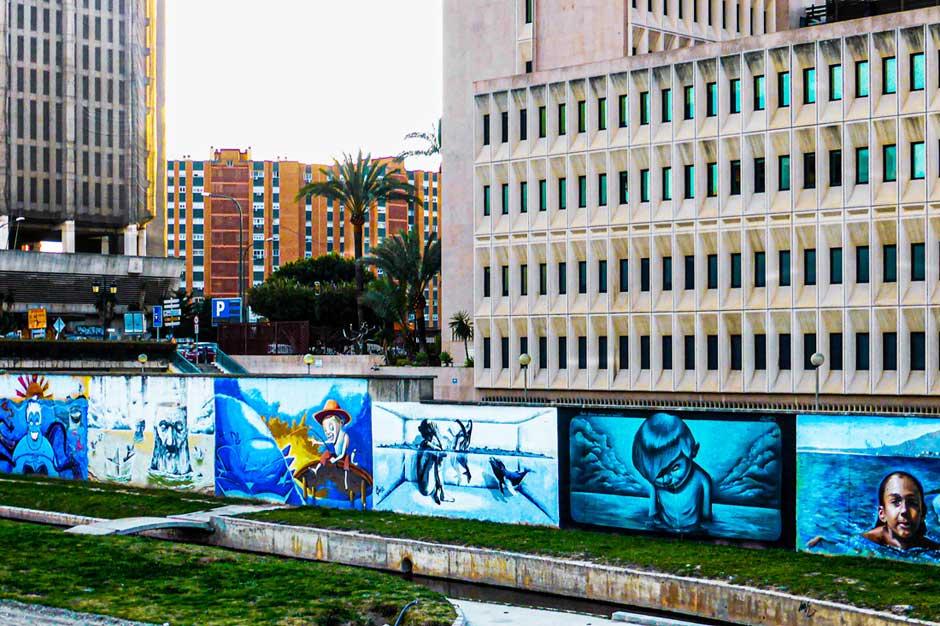 Street art and graffiti by riverside properties of Soho in Málaga, Spain