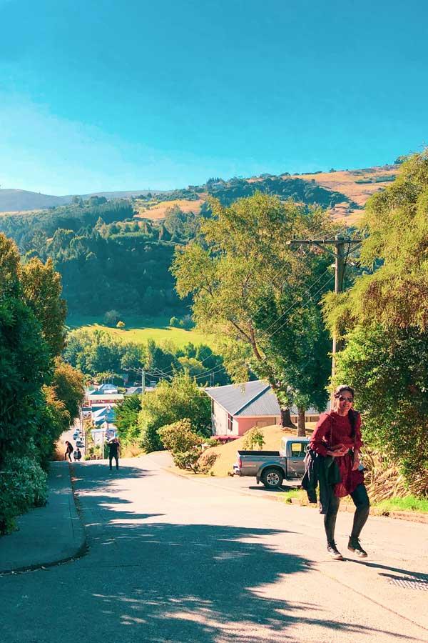 Zarina climbing Baldwin Street in Dunedin, New Zealand, the world's steepest street
