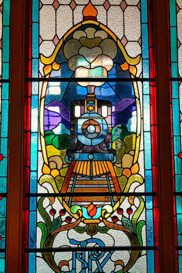 stained-glass window depicting a locomotive in the Dunedin Railway Station