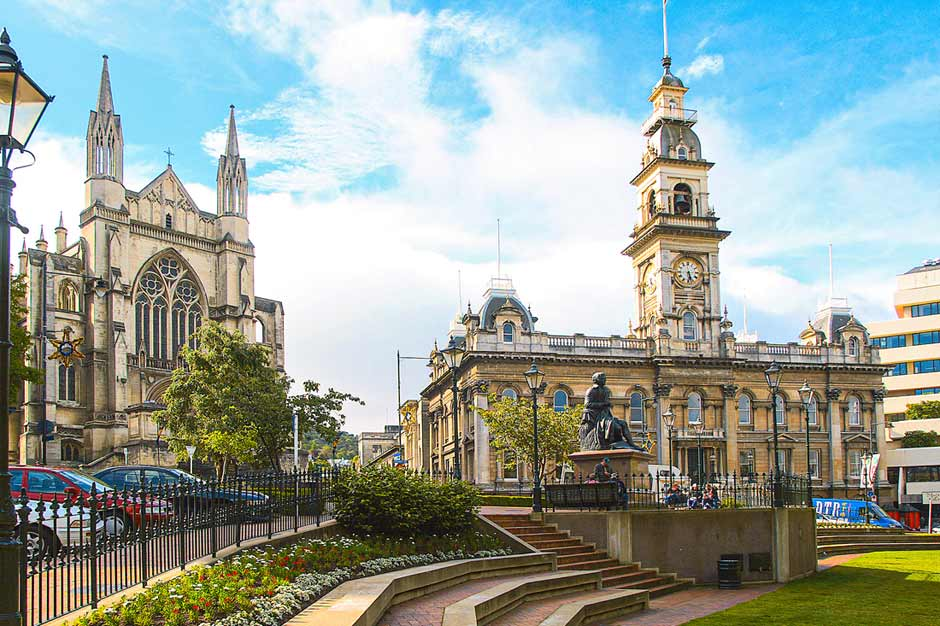 The Octagon in Dunedin with the Town Hall, Robert Burns statue and St Paul's Cathedral