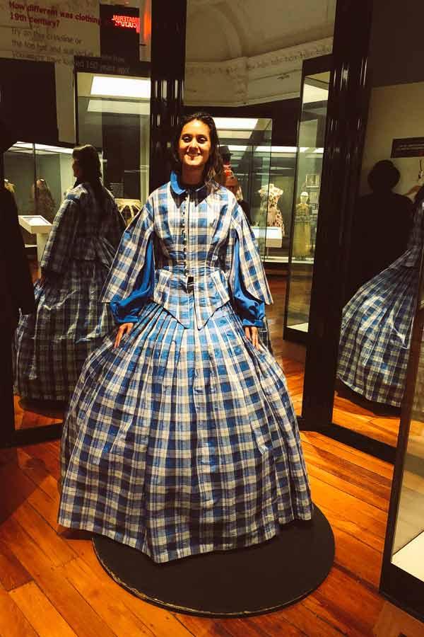 Zarina wearing a 18th-century dress in the Otago Settlers Museum in Dunedin, New Zealand