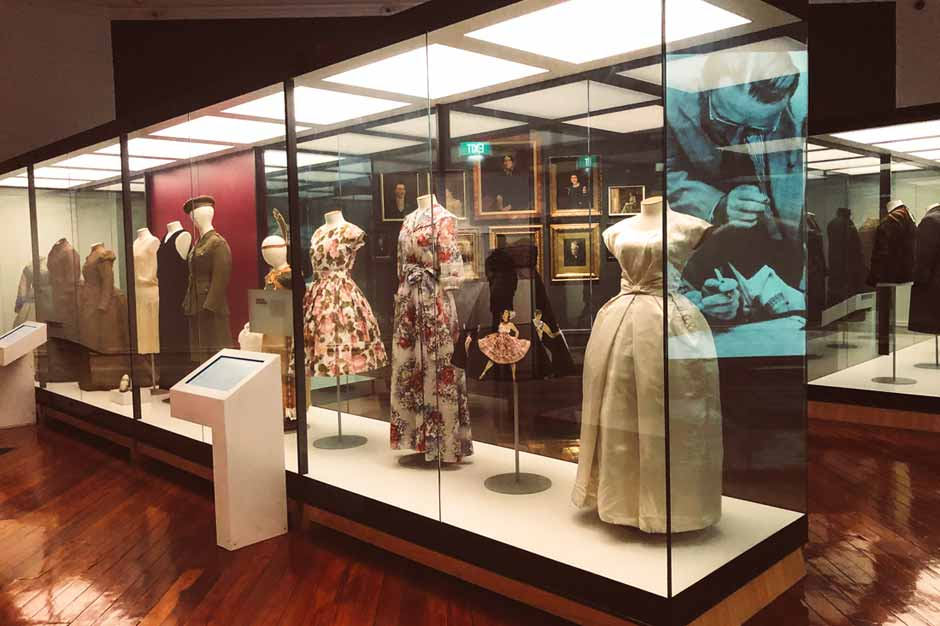 display of historical women's clothing in Otago Settlers Museum in Dunedin, New Zealand