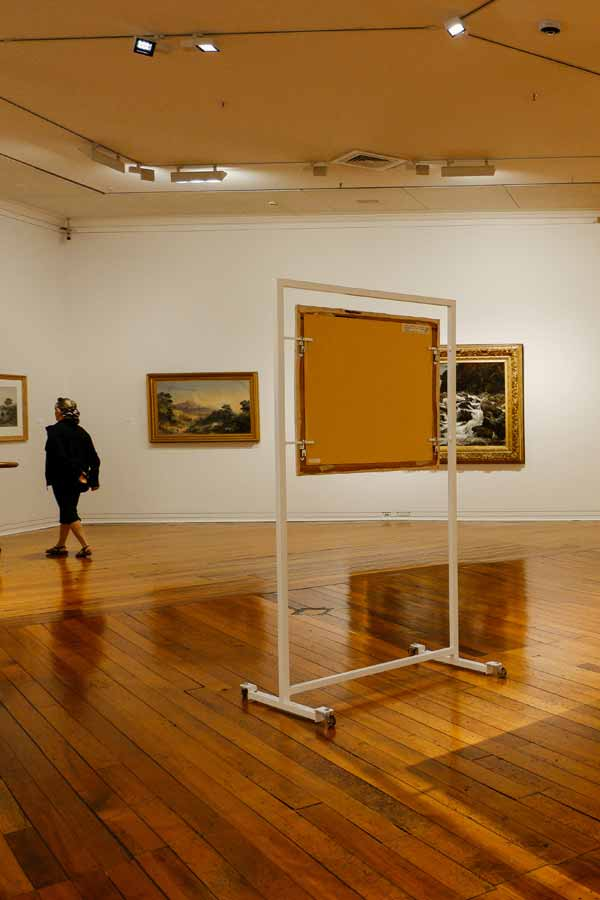 inside a room with landscape paintings in the Dunedin Public Art Gallery, New Zealand
