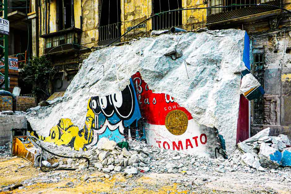 Derelict buildings with remnants of Andy Warhol-inspired street art in Málaga