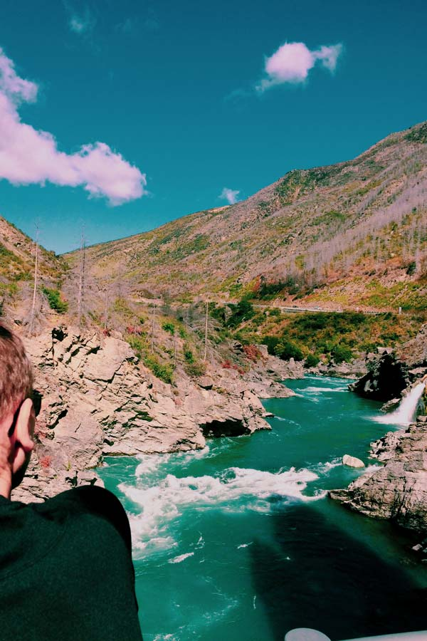 my husband overlooking Roaring Meg in the Kawarau River during our New Zealand South Island road trip