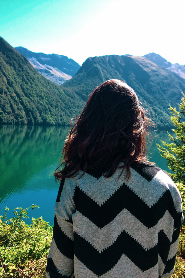 Zarina looking over Lake Gunn, a popular stop during the South Island road trip between Queenstown and Milford Sound