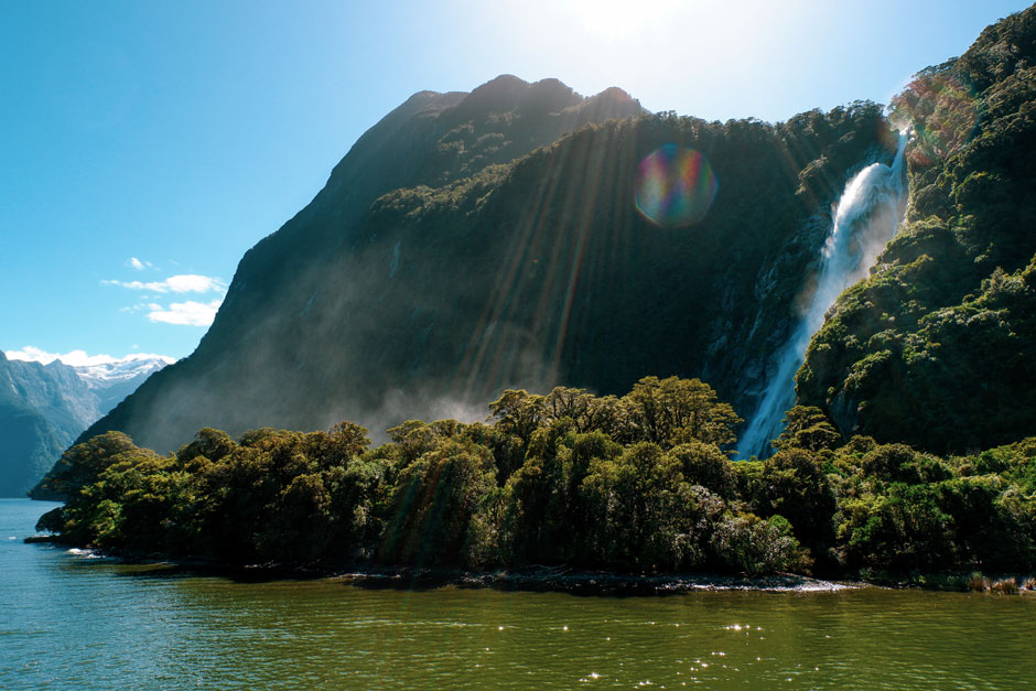 waterfall rolling down hills in Milford Sound
