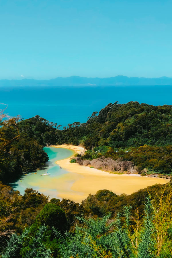 looking down on the golden sand beaches of Abel Tasman National Park, a must-see on the South Island of New Zealand