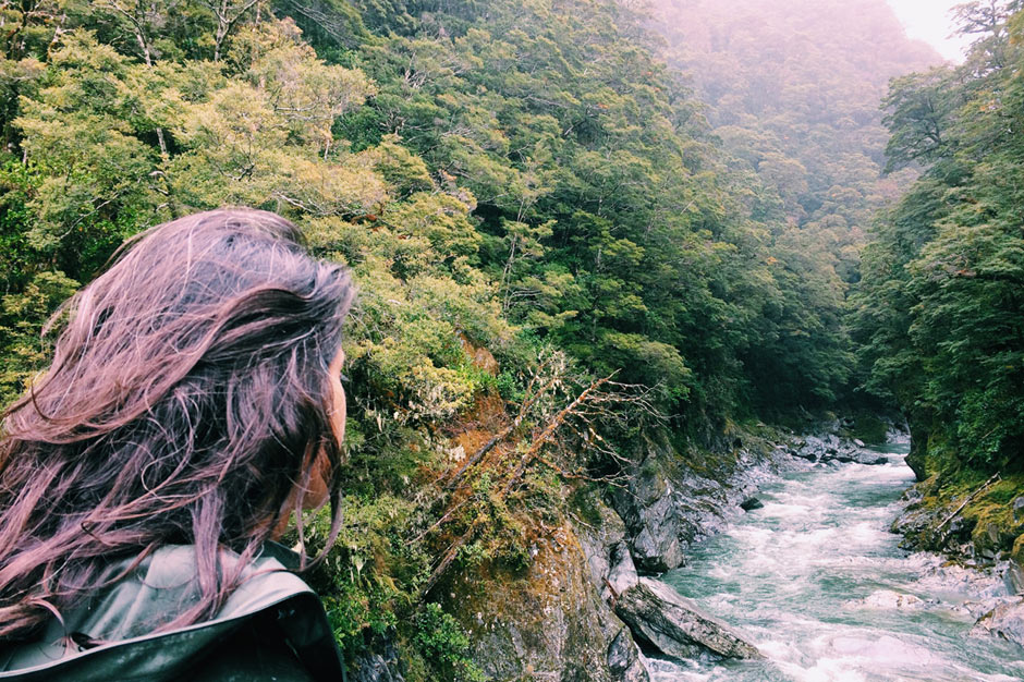 Zarina looking down on the Blue Pools, a stop on their New Zealand South Island road trip