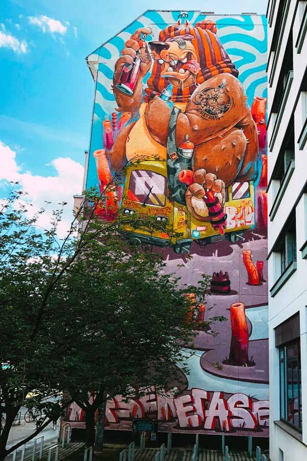 large mural of a cartoon-like bear in Friedrichshain