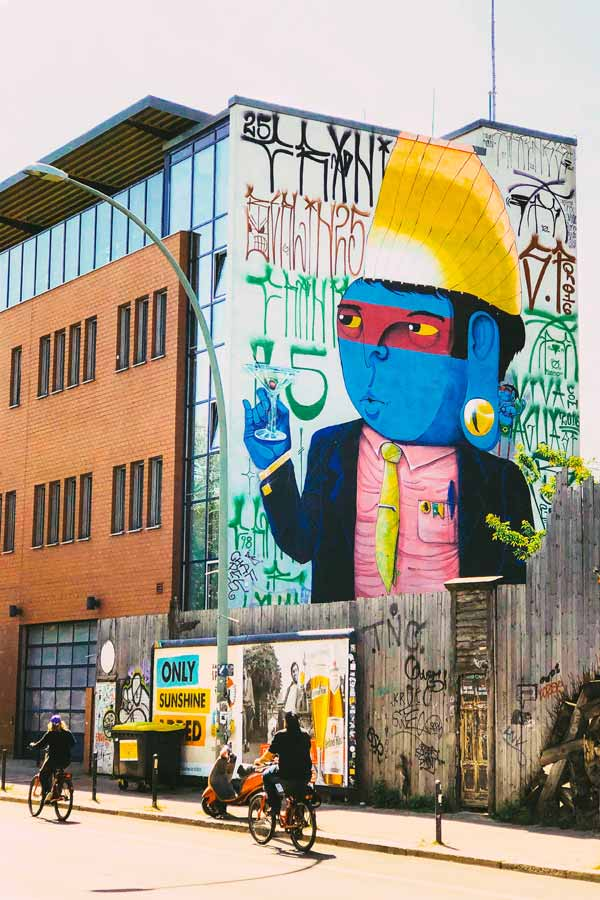 large wall painting by Cranio of one of his signature blue figures on Holzmarktstrasse in the Kreuzberg neighbourhood