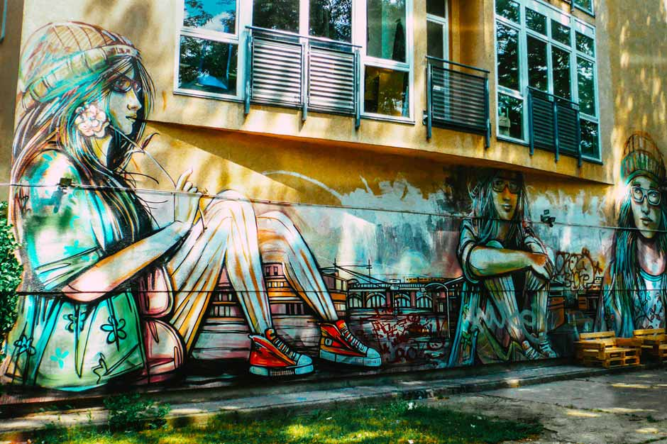 Suspended by Alice Pasquini on Warschauerstrasse in Friedrichshain featuring 6 large female portraits