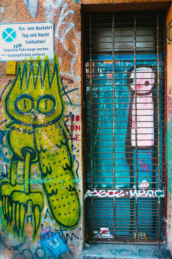 mural by Dscreet of his signature owl and a stick figure by Stik in Berlin