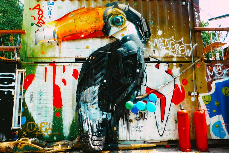 Large artwork of a tucan made out of rubbish by street artist Bordalo II in Raw Gelände, Berlin