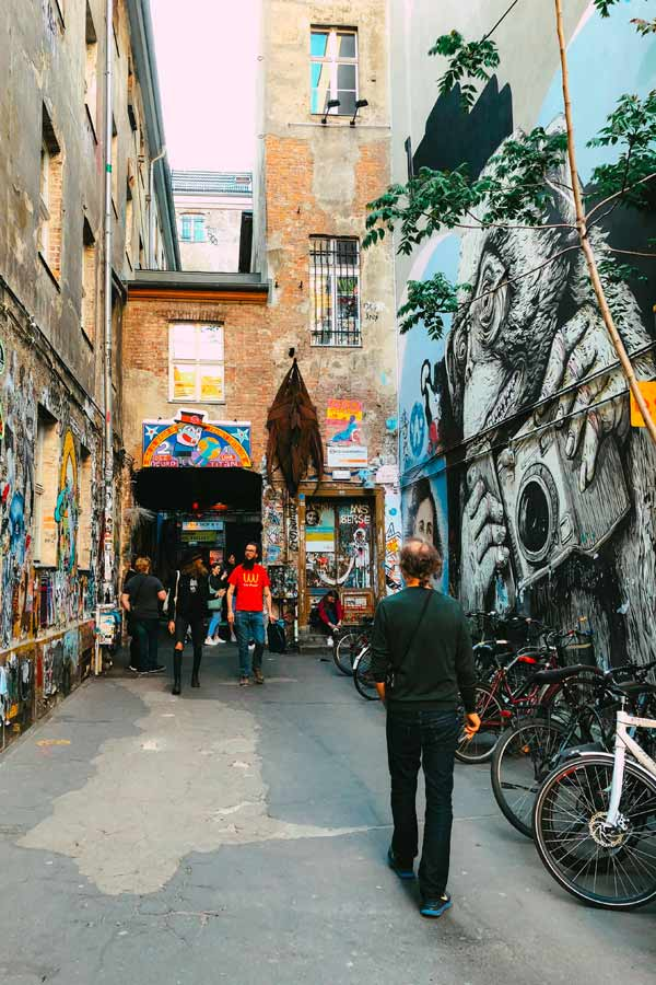 looking into the alley of Haus Schwarzenberg on Rosenthaler Strasse which is covered in street art