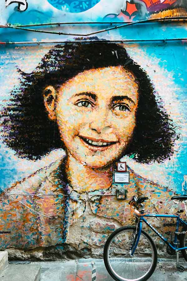 Portrait of Anne Frank by Jimmy C which is entirely made out of large paint dots