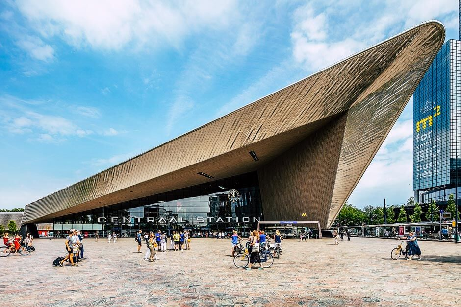 exterior of Rotterdam Central Station with good view of its steel V-shaped canopy