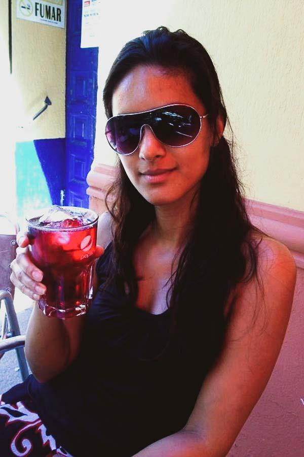 Zarina holding a glass of tinto de verano