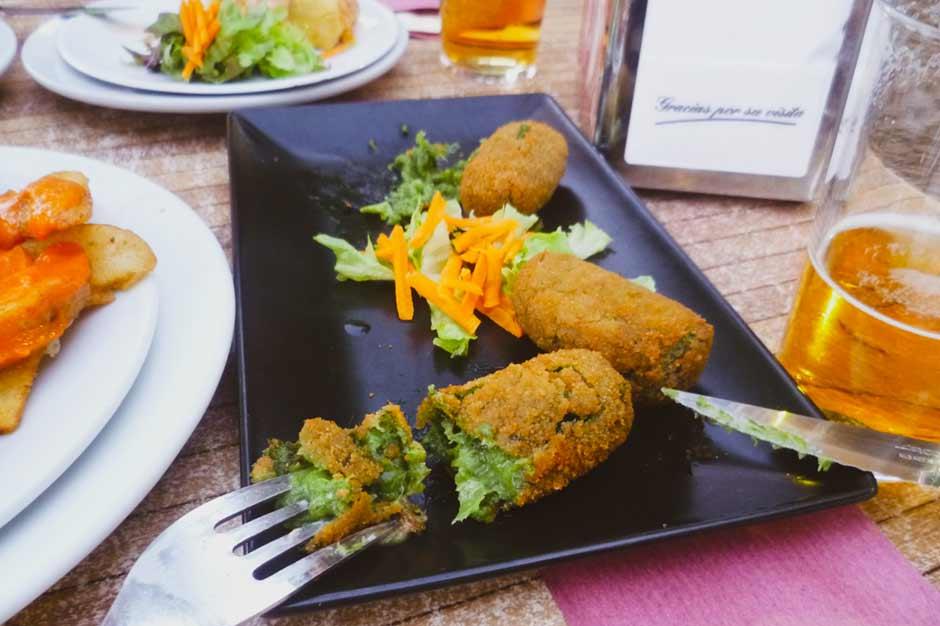 a small plate of croquetas de espinaca, spinach croquettes