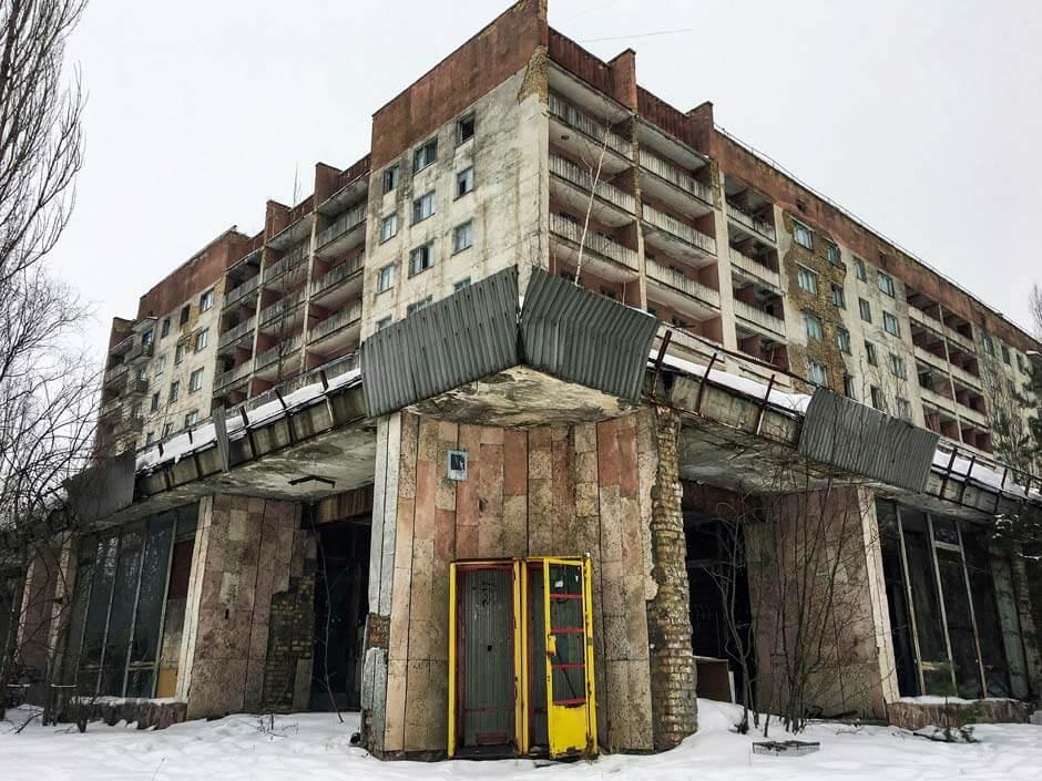 large concrete building in the deserted Pripyat amusement park in Ukraine