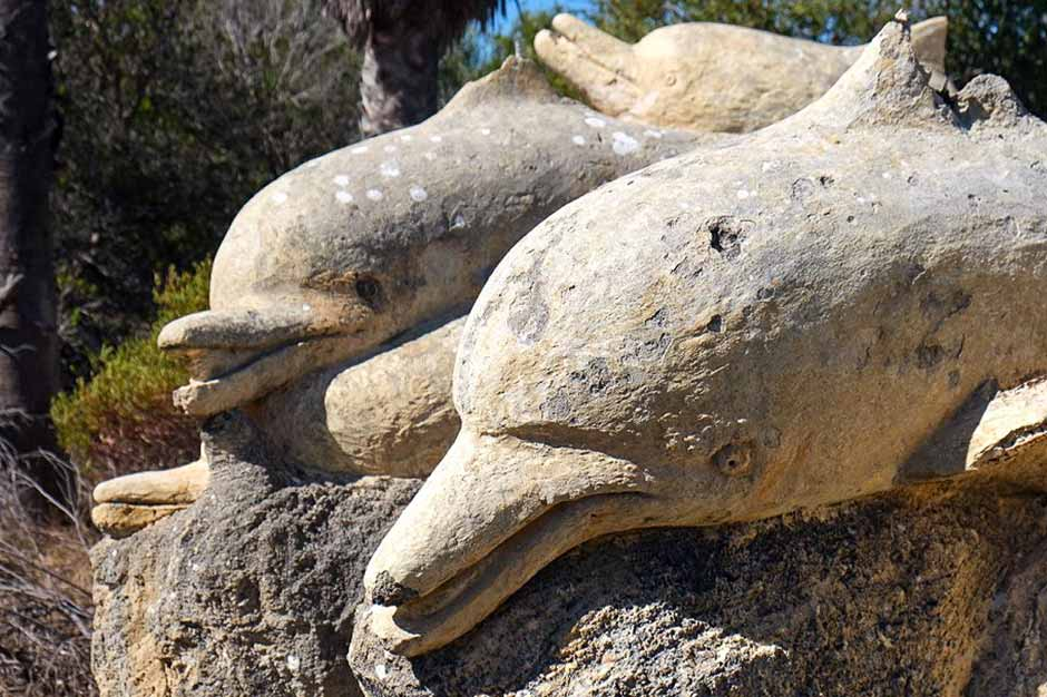 damaged dolphin sculptures in the former Atlantis Marine Park in Perth, Australia