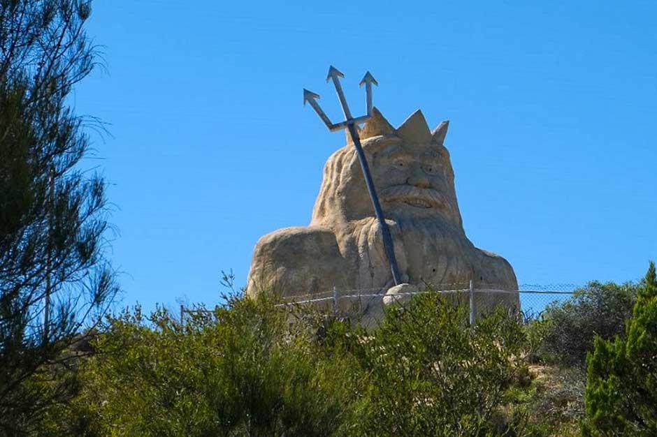 large cartoonish yet eerie sculpture of Neptune in the former Atlantis Marine Park in Perth, Australia