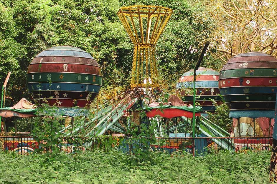overgrown and neglected attraction in the former Yangon amusement park in Myanmar