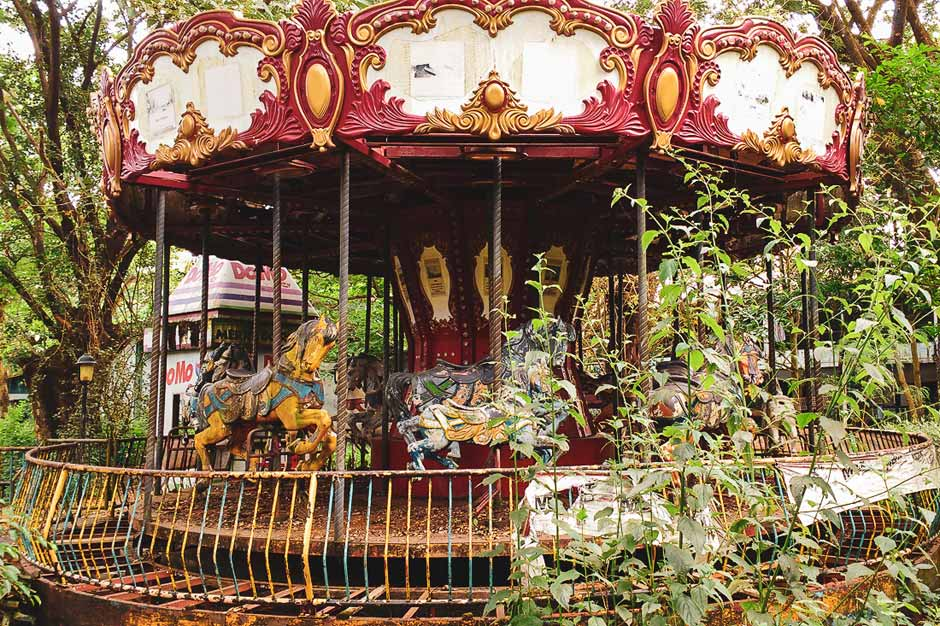 neglected and overgrown merry-go-round in the former Yangon amusement park in Myanmar