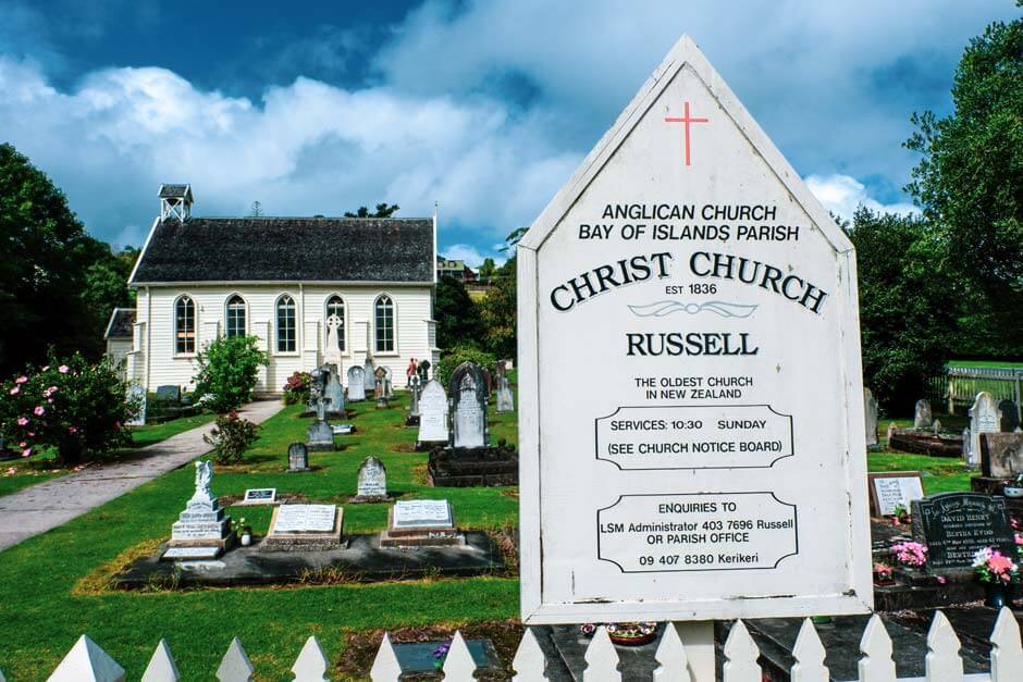 Information sign, cemetary and church building of Christ Church in Russell, New Zealand