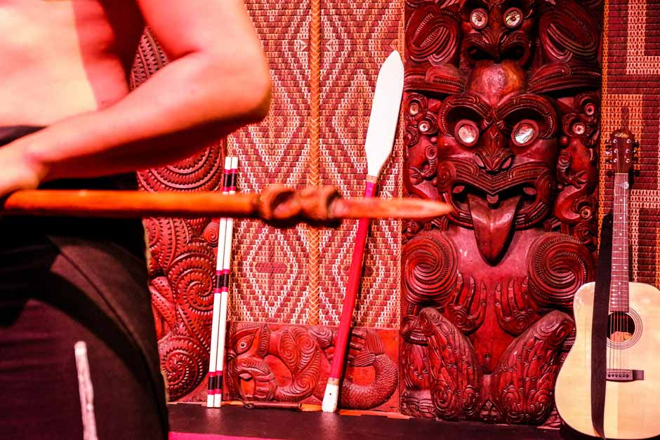 cultural performance in the Maori meeting house in Waitangi, zooming in on the intricate carvings